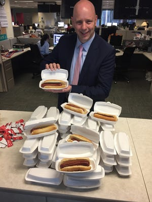 Courier-Journal Executive Editor Joel Christopher enjoys a free hot dog.