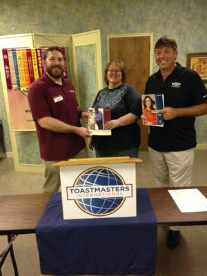 In this file photo, Toastmasters International District 25 Area 51 Director at the time Michael Battaglino, left, presents training manuals to then-newly elected officers for 2017-2018. The Wichita Falls Toastmasters Club is the oldest in Texas.