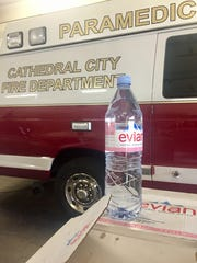 A Cathedral City Fire Department vehicle is pictured with water donated to the department for emergency preparedness.