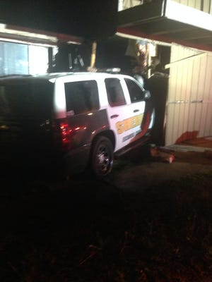 An Escambia County Sheriff's Office patrol vehicle crashed through a house at 3309 N W St. on Sunday, Oct. 8, 2017.