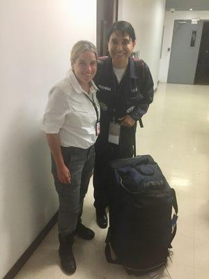 Dr. Mona Khanna (right) with Carmen Yulín Cruz, mayor of San Juan, Puerto Rico.