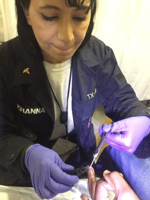 Dr. Mona Khanna tends to a patient during her deployment to Puerto Rico.