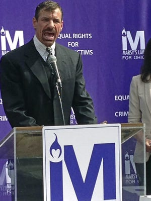 In this June 22, 2017, file photo, Henry Nicholas, for whose murdered younger sister Marsy's Law is named, speaks outside the Ohio Secretary of State's office in Columbus, Ohio. Nicholas is the billionaire technology executive from California behind one of the two ballot issues in Ohio's Tuesday, Nov. 7, 2017, general election, the crime victims' rights measure labeled Issue 1.
