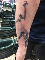 Diehard Indiana Pacers fan and Bristol, Englad native Aaron Eamer has a tattoo of Pacers legend George McGinnis on his right arm, opposite that of Reggie Miller tattoo. He wants to one day cover his his entire right arm in Pacers-themed tattoos.