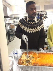 Infinite Culcleasure, 44, serves dinner at an event kicking off his mayoral campaign on Dec 15, 2017