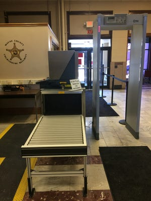 The security checkpoint inside the east entrance of the Wayne County Courthouse includes a scanner for bags and metal objects as well as a walk-through metal detector.
