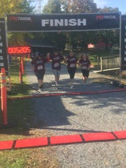 David Rider, second from the right, crosses the finish