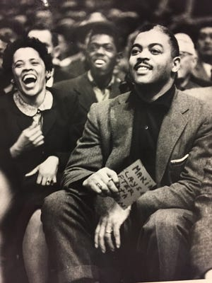 Ray Crowe, coach of the Crispus Attucks championship teams in 1955 and 1956, sits in the stands at the final game in 1959 at Hinkle Fieldhouse.