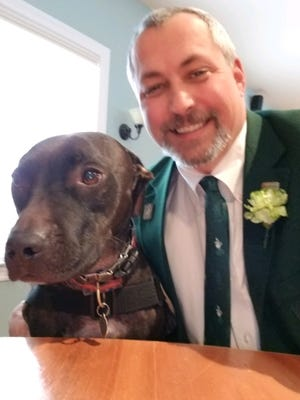 Jeff Mullins and his service dog, Zoey.