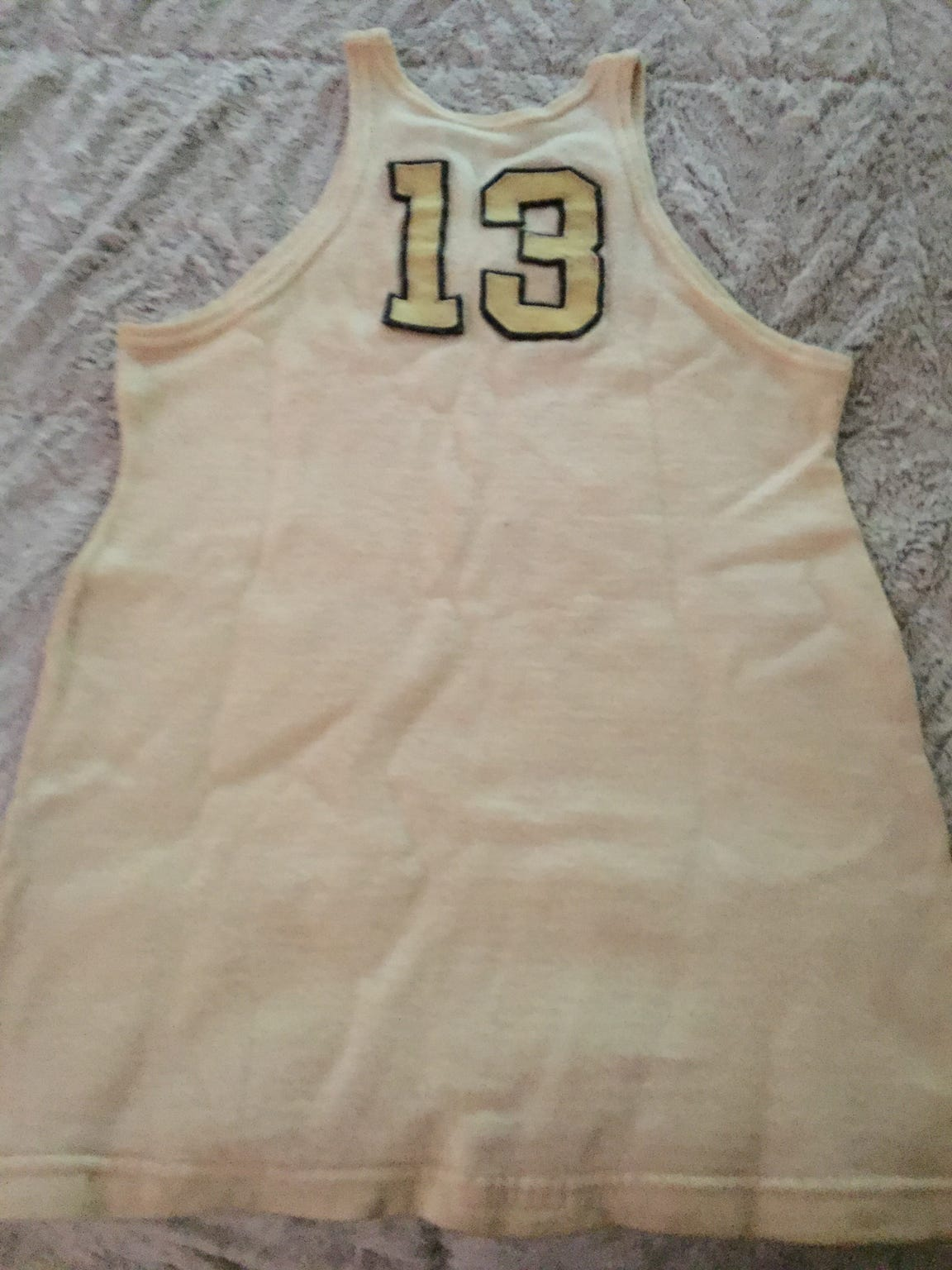 The back of the 1930-32 era John Wooden jersey owned