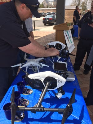 Firefighter Jamey Miller readies Richmond Fire Department drones for a Friday demonstration at Elstro Plaza.