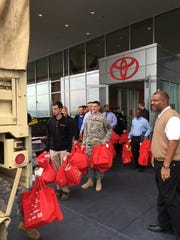 Employees at Toyota of Cool Springs host a toy drive