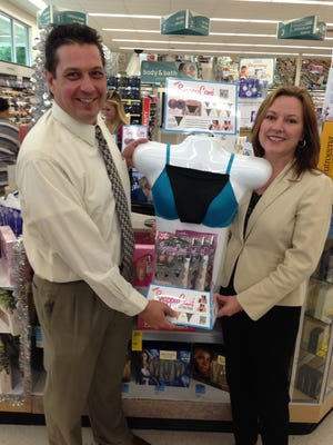 D.J. and Michelle De Sousa stand in front of a display for Snappy Cami at the Walgreens at Colonial and Treeline boulevards