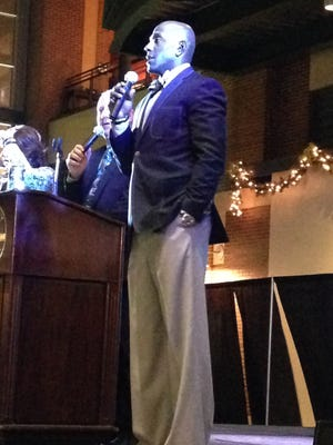 Former Green Bay Packers wide receiver Donald Driver choked up while telling the crowd at Friday's Habitat for Humanity fundraiser about his childhood homelessness.