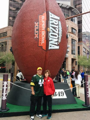 Jeff and Tina Carr of Bellevue have spent time this week volunteering at Verizon Super Bowl Central in downtown Phoenix. They scored tickets to today's Super Bowl in the NFL ticket lottery.
