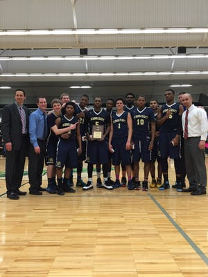 Celebrating after winning the NJCAA District 10 championship Saturday at Delta College is Schoolcraft College's men's basketball team.