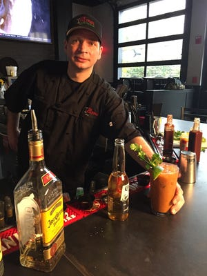 Chris Kelly of the Jellyfish Restaurant and Bar gets crazy with the Cheez Whiz for his turn in the PNJ Cocktail Challenge.