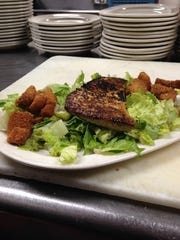 Goin Nuts' tuna Caesar. A grilled filet of tuna sits atop lettuce and croutons, making it a tasty, healthy dish.