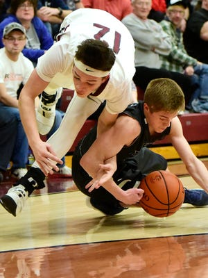 Genoa's Sam Sutter and Lake's Mikey Szymanski scramble for a loose ball Friday.