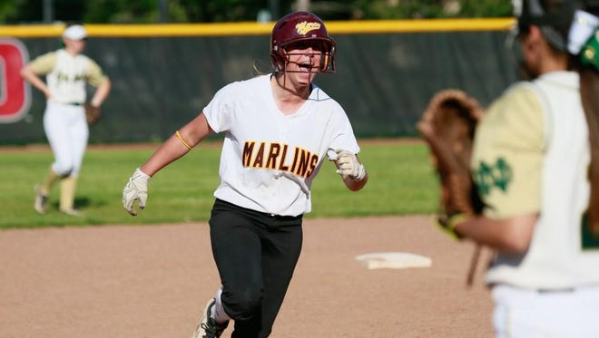 Farmington Hills Mercy's Anna Dixon rounds the bases Monday after hitting her second home run against Notre Dame Prep in the Catholic League championship.