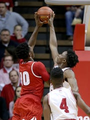 IU's OG Anunoby (3) blocks the shot by Wisconsin forward