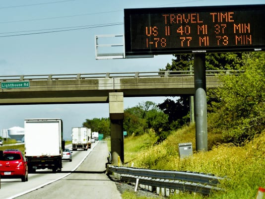 An electronic PennDOT message board gives estimated arrival times for drivers in the northbound lane of Interstate 81, Guillford Township.