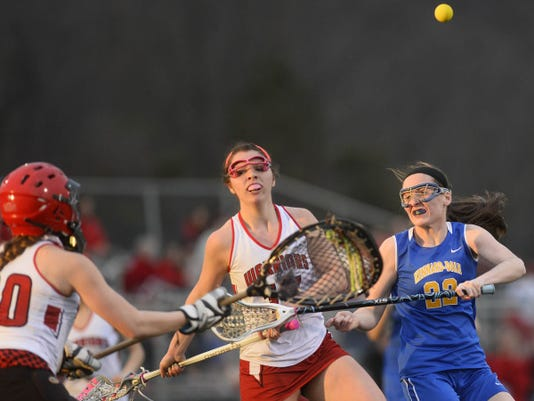 Kennard-Dale's Morgan Day and Susquehannock's Michella Salvitti chase the ball after a shot was blocked during a girls' lacrosse game at Susquehannock High School on April 2. Kennard-Dale won the contest, 11-6. The two teams square off again tonight at 5:30 p.m. in the YAIAA championship.
