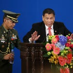 Philippine president says he won't severe ties with US