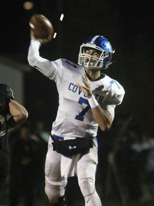 CovCath senior AJ Mayer throws the ball up the field during a KHSAA Class 5A state football semifinal with Covington Catholic playing at South Warren Nov. 24, 2017 at South Warren HS in Bowling Green, KY.