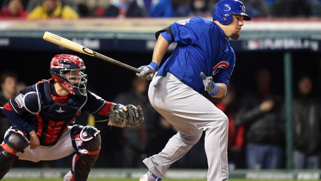 Chicago Cubs player Kyle Schwarber hits  a RBI single against the Cleveland Indians in the 5th inning in game two of the 2016 World Series at Progressive Field on Oct. 26.