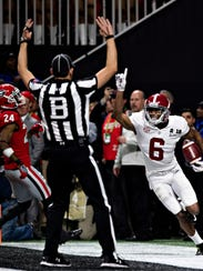 Alabama wide receiver DeVonta Smith celebrates the game-winning touchdown against Georgia in January.