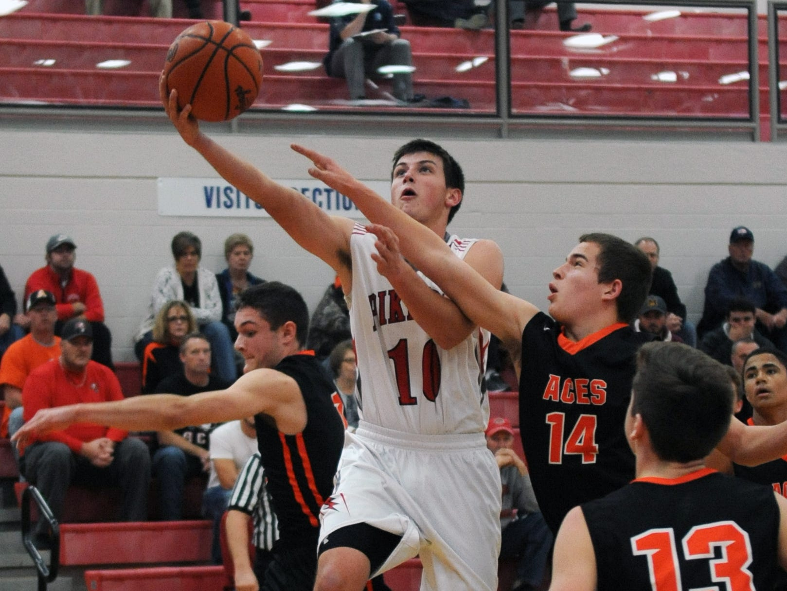 Piketon's Casey Moore jumps up for a shot against Amanda-Clearcreek Friday at Zane Trace High School.