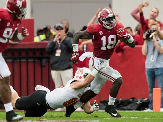 Alabama linebacker Dylan Moses (18) returns an interception against Mercer in first half action at Bryant Denny Stadium in Tuscaloosa, Ala. on Saturday November 18, 2017. (Mickey Welsh / Montgomery Advertiser)