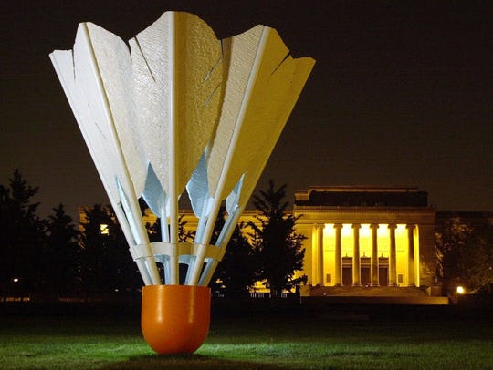 A giant shuttlecock stands on the south lawn of the