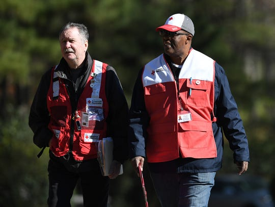 Red Cross volunteers arrive after an early morning