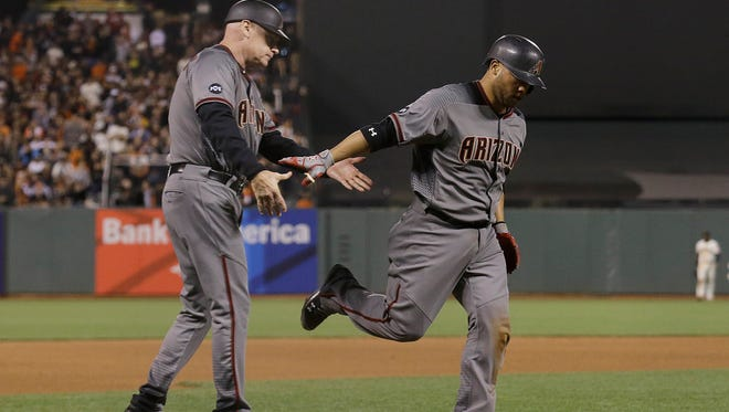 Arizona Diamondbacks' Welington Castillo is congratulated by third base coach Matt Williams after hitting a solo home run against the San Francisco Giants during the fourth inning in San Francisco, Monday, April 18, 2016.