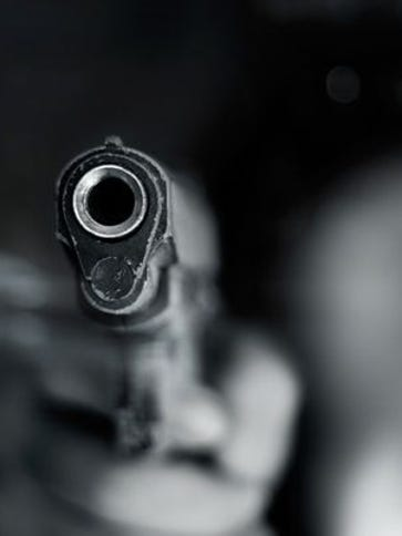 Close-up stock image of a semi-automatic handgun.