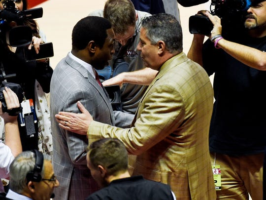 Alabama head coach Avery Johnson and Auburn head coach Bruce Pearl greet each other prior to the game at Coleman Coliseum.