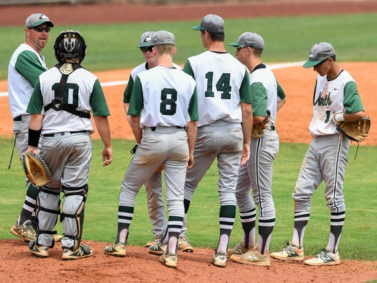 North baseball coach Jeremy Jones talks to his team on the mound during the sectional championship last year. The IHSAA is considering a proposal to lift travel restrictions for members schools.
