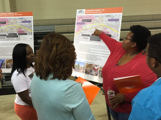 Lafayette residents discuss the I-49 project April 27, 2016 at an open house.