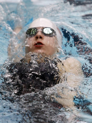 Emma Doughty, 11, of Hilton, swims in the 200-meter backstroke at the Deaf International Short Course Swimming Championships at RIT on Jan. 17.