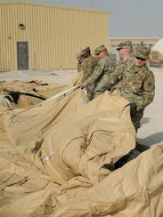 Soldiers from the deployed element with the 11th Air