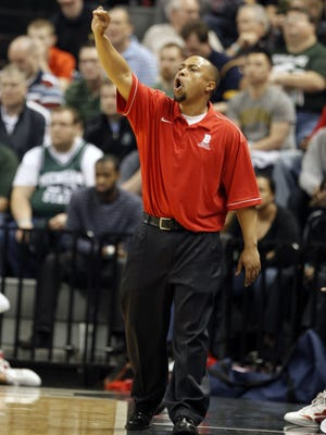 Flint Beecher basketball coach Mike Williams works March 24, 2012, at the Breslin Center in East Lansing.