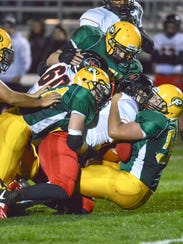 Pennfield defenders swarm the Nortwest running back