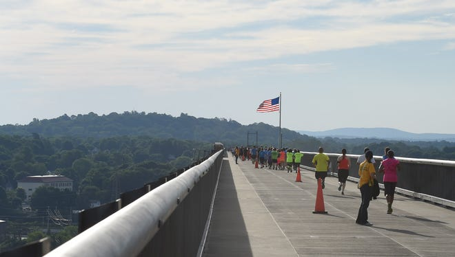 Runners move across the Walkway Over the Hudson during the Walkway Marathon on June 12.