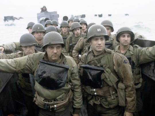 "Soldiers prepare to land at Omaha Beach in ""Saving Private Ryan."""