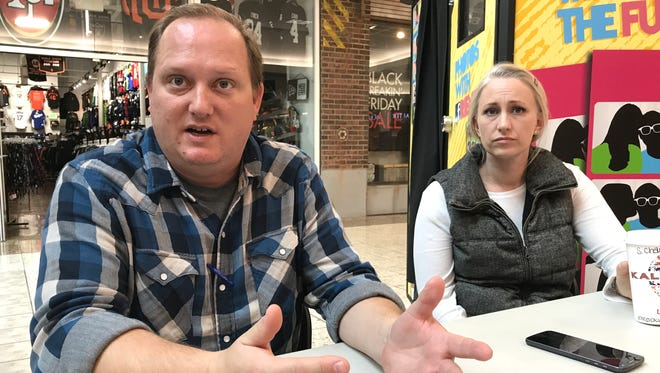 Patrick Gorman, left, and his wife, Jill, are on a signature-gathering campaign to re-examine whether commercial recreational and medicinal marijuana activity should be allowed in the unincorporated areas of Shasta County. They were collecting signatures for the referendum Saturday at the Mt. Shasta Mall.
