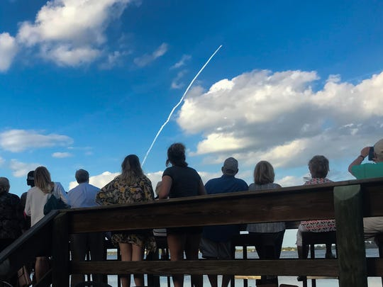 The Atlas V launch as seen from River Rocks in Suntree.