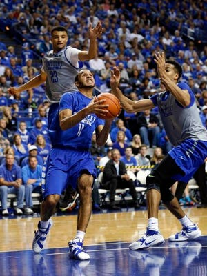 Oct 27, 2015; Lexington, Kentucky, USA; Kentucky Wildcats guard Mychal Mulder (11) drives the ball to the basket against guard Jamal Murray (23) and forward Skal Labissiere (1) in the second half of the Blue White scrimmage at Rupp Arena. Mandatory Credit: Mark Zerof-USA TODAY Sports