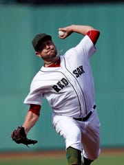 Boston Red Sox starting pitcher Brian Johnson delivers during the first inning of a baseball game against the Seattle Mariners at Fenway Park in Boston, Saturday, May 27, 2017. (AP Photo/Charles Krupa)